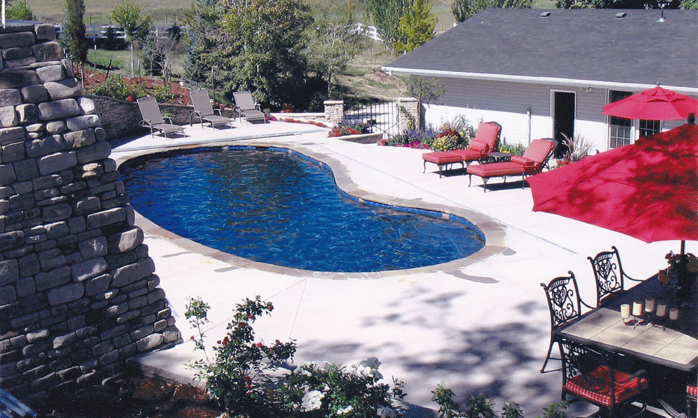 Irregular shaped pool with automatic cover